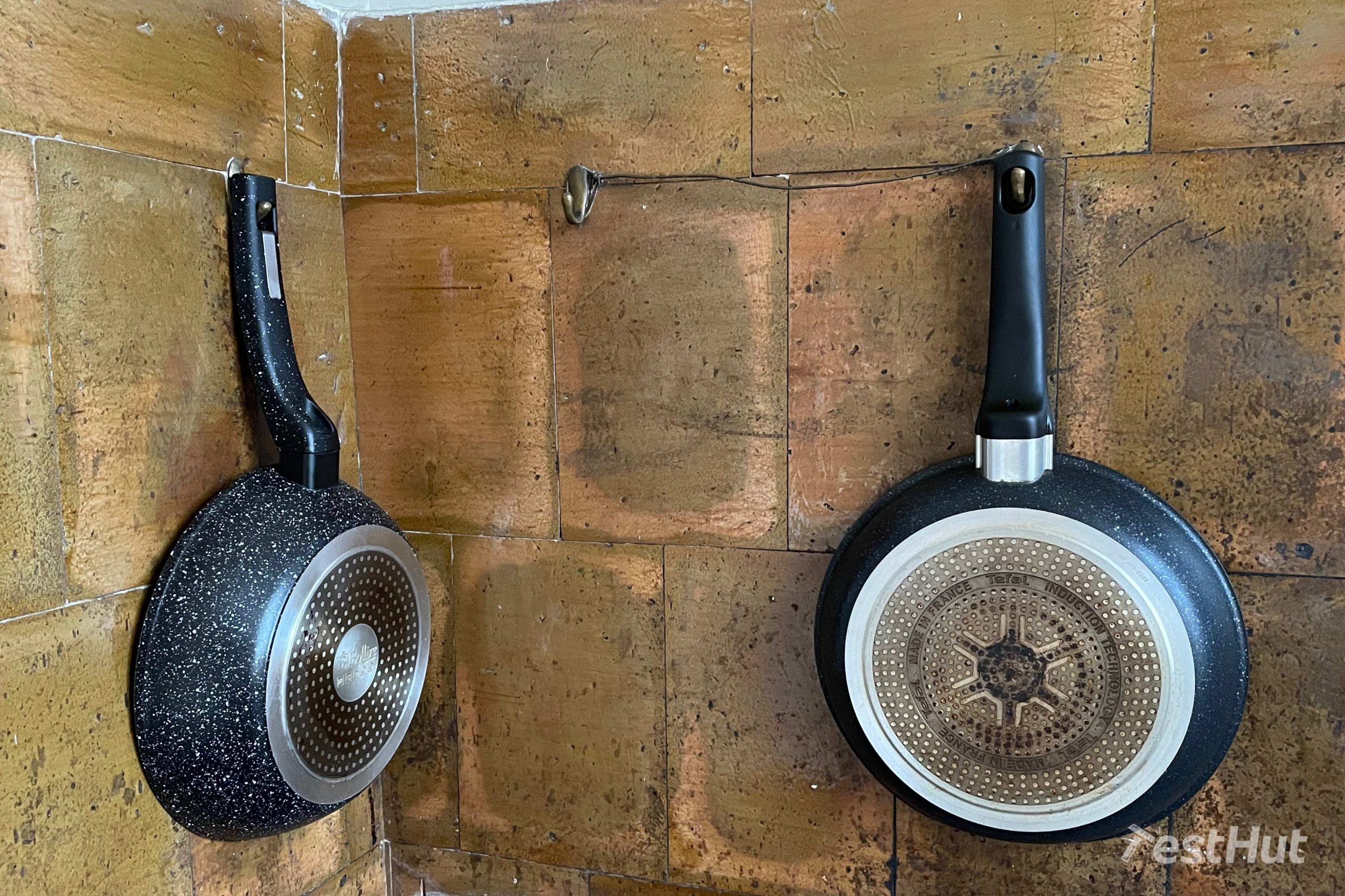 Frying pans hanged on a wall